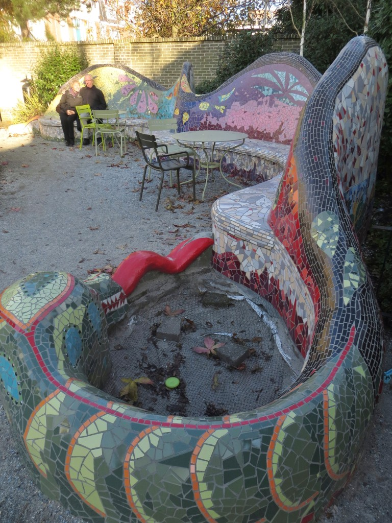 Mosaic bench and sandbox built by neighbors in Emma's Garden