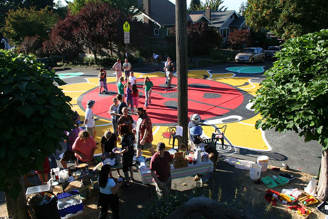 Residents of Seattle's Wallingford neighborhood paint a gigantic ladybug in their intersection.