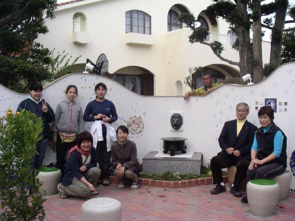 Neighbors gather in what was formerly a parking space for a home in Matsudo, Japan.