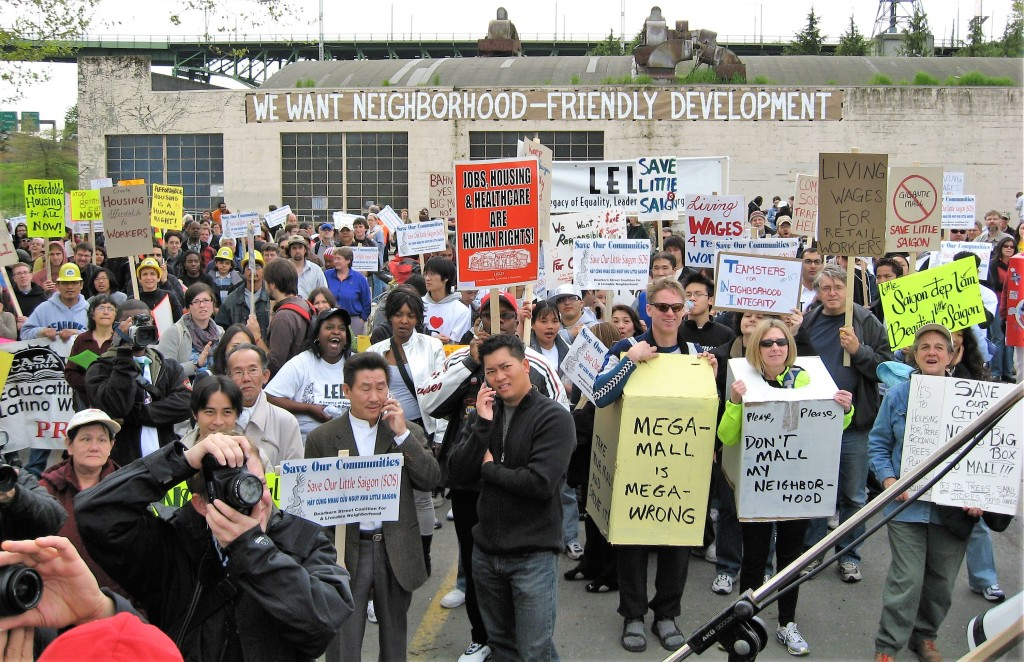 Community members successfully protest against a proposed mall that would have contributed to the gentrification of Seattle's Little Saigon neighborhood.